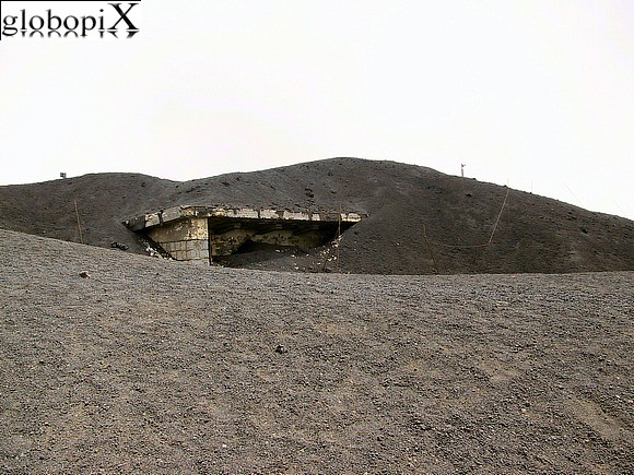 Etna - Log cabin submerged by lava flow.